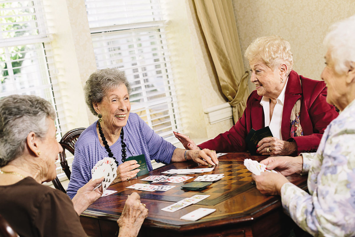 Senior Living Residents Playing Cards