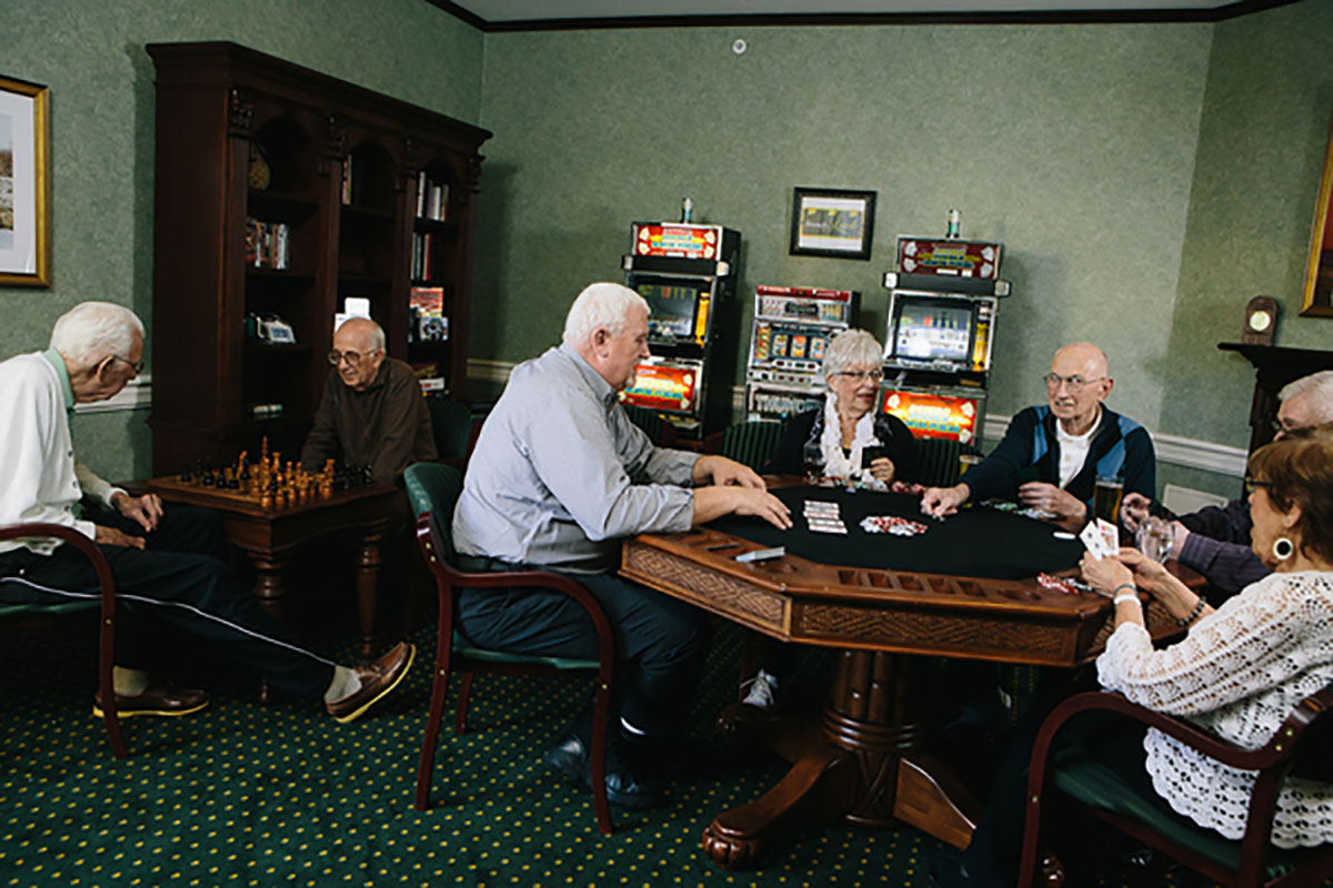 Residents Play Cards in Game Room