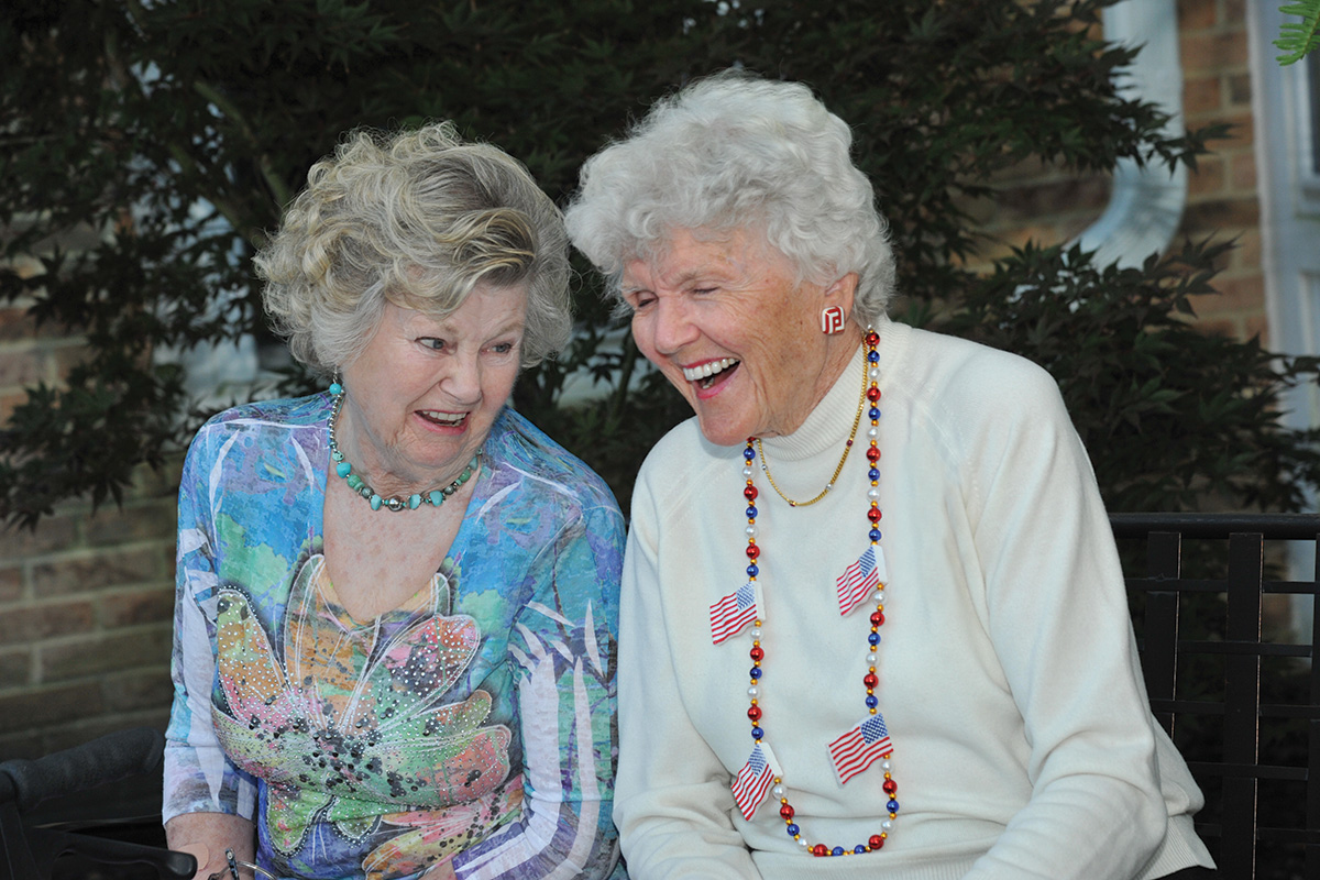 Two Female Senior Residents Laughing