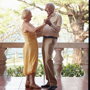 Happy Senior Couple Dancing on the porch