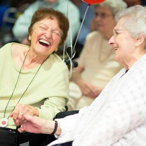 Female Residents Laughing and Hold Hands