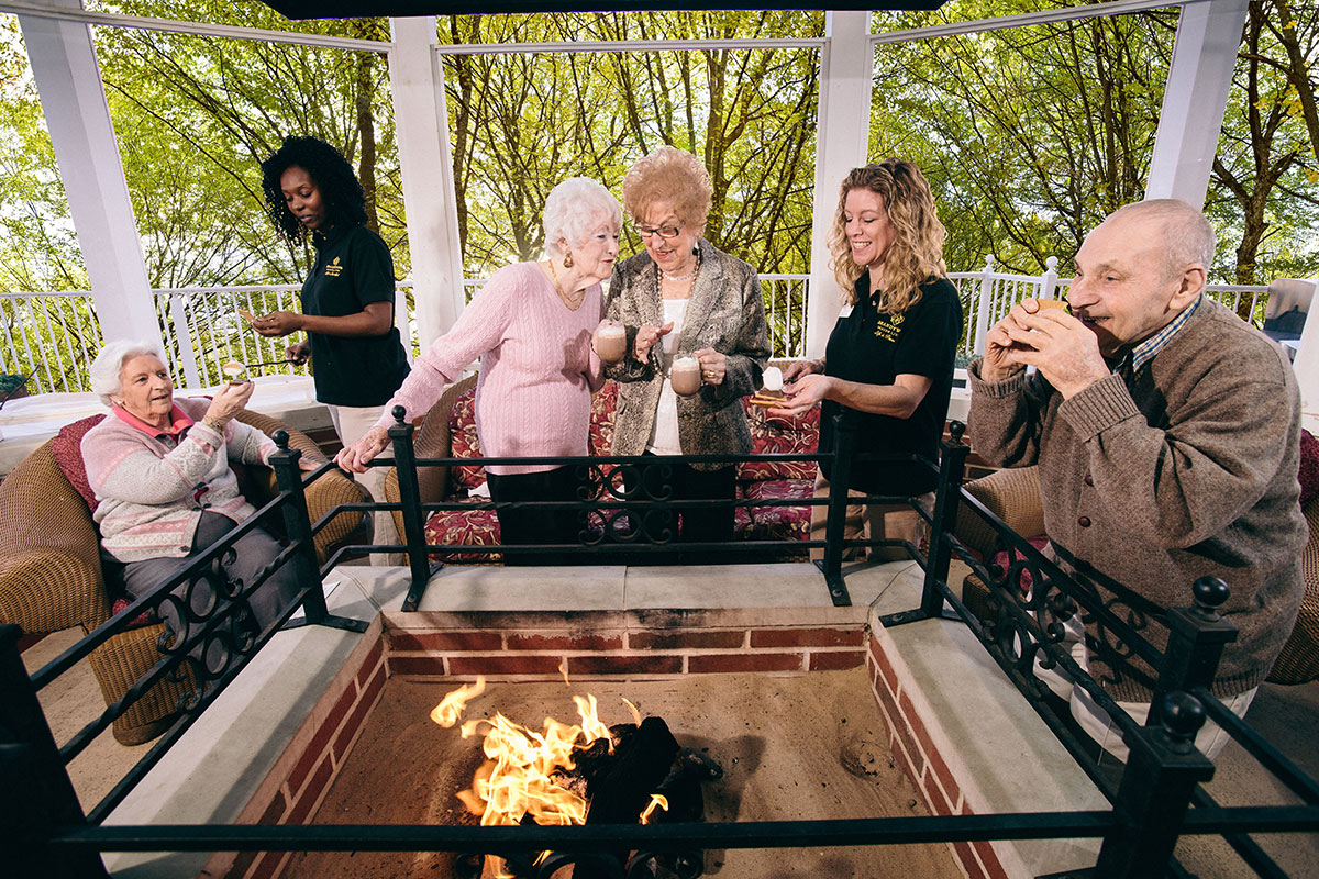 Senior Living Residents Enjoying Fire Pit