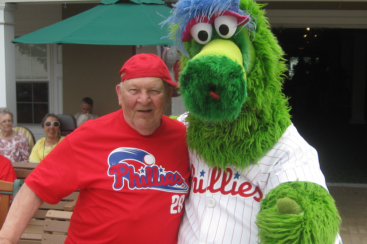 Male Resident Posing with the Philly Phanatic