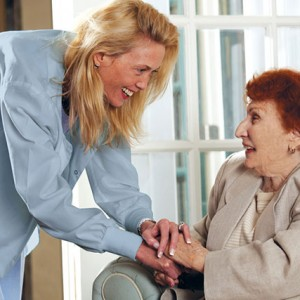 Senior Resident with Caring Nurse