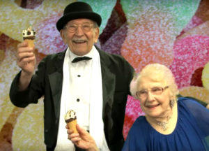 Senior Man in a Tuxedo and Senior Woman Holding Ice Cream Cones