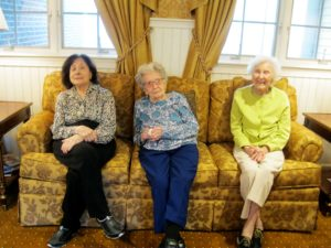 Three Female Litchfield Residents, Older Than the Right to Vote, Seated on Sofa
