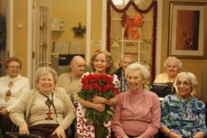 Vasilisa Stenko Accepts Flowers from Residents