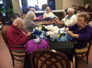 Group of Residents Making Pilows