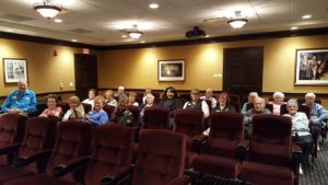 Seniors Seated in Movie Theater