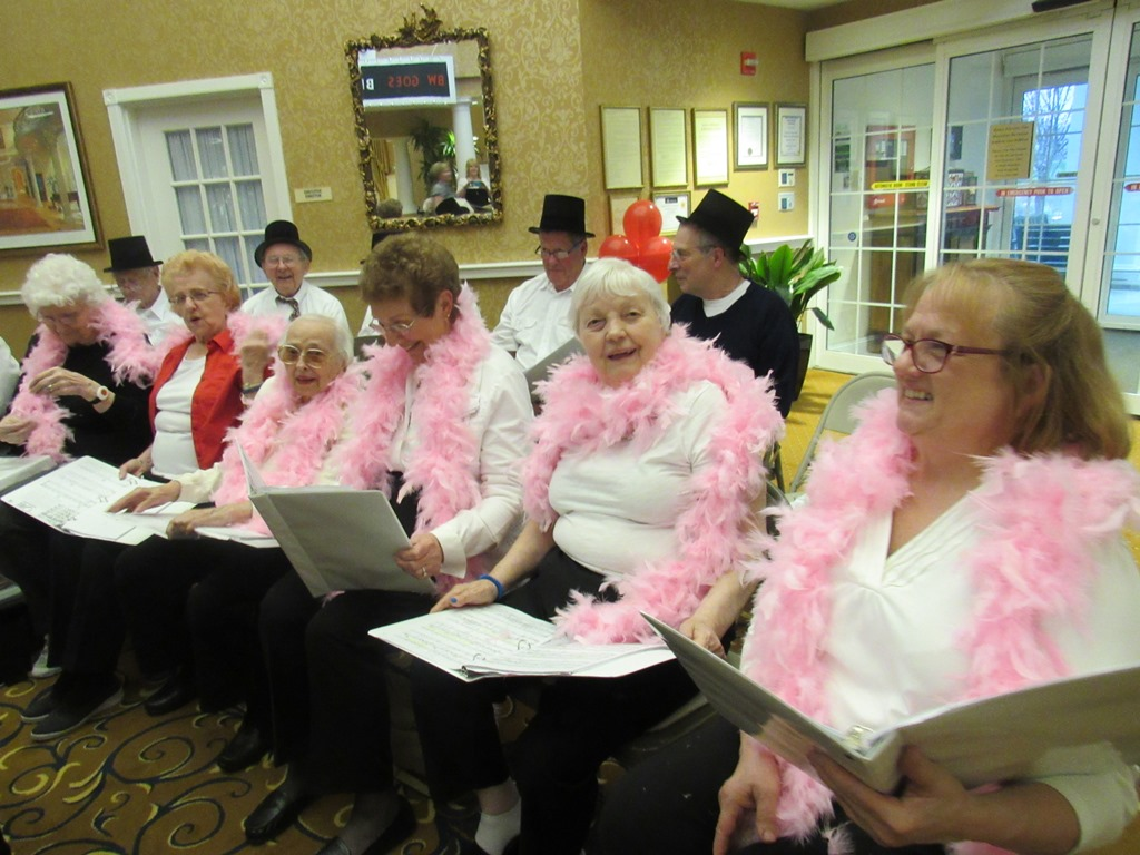 Brandywine Living at Litchfield Choir Featuring Pink Boas and Singing