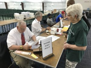 Mary Van Sciver Asking Question at Registration Table