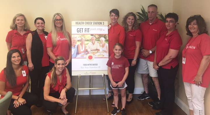 BAYADA Employees Pose with Get Fit Event Sign