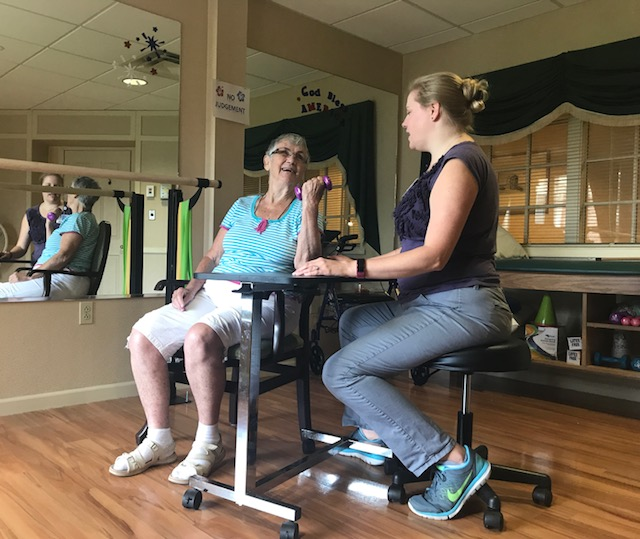 Patricia Cray Lifting Weights with Virtua Therapist