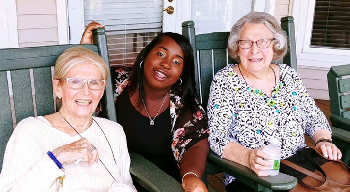 Amber Mansfield Poses with Senior Residents