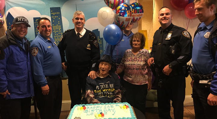 Louie Schlifstein with NYPD Officers and Birthday Cake