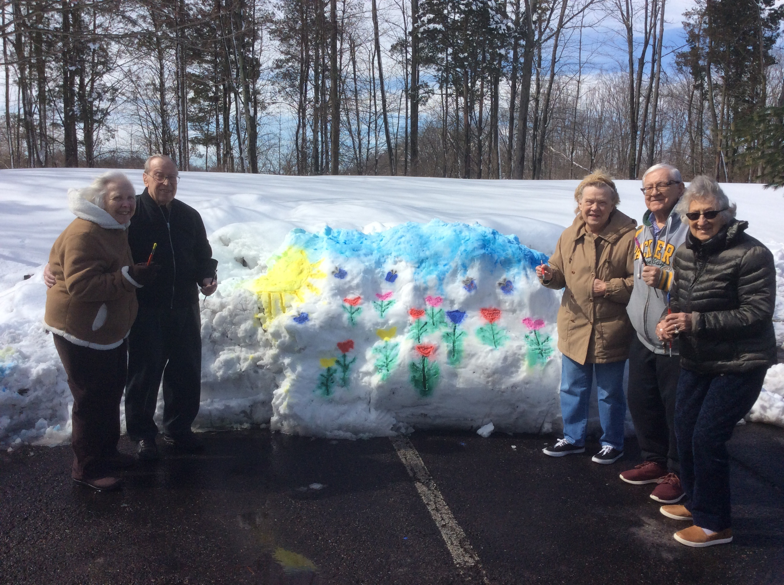 Seniors Pose with Snow Art