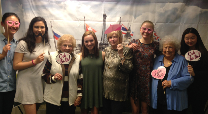 Students and Seniors Pose with Paris Props