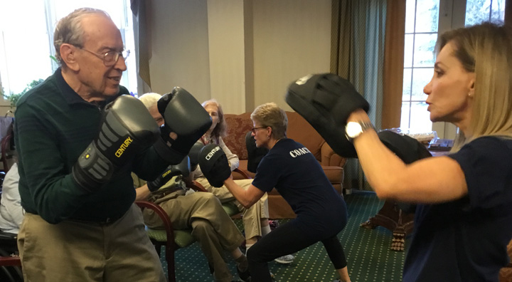 Residents learn boxing techniques from Princeton's Parkinson's Program