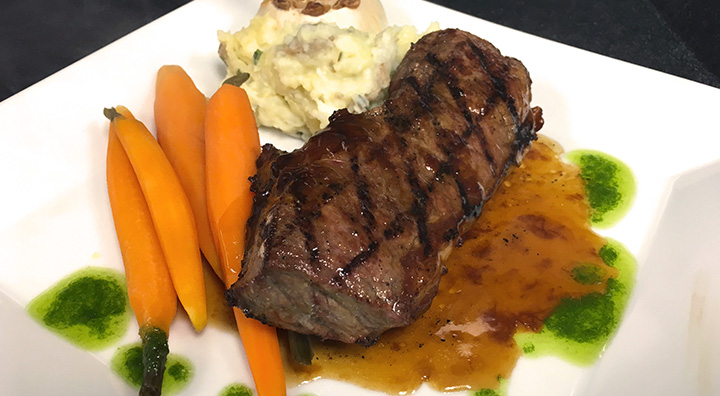 Filet of Steak Served with Carrots and Mashed Potatoes