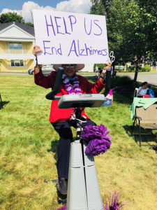 Female Resident Hold Alzheimer's Donation Sign