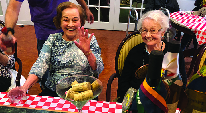 Two Female Brandywine Living at Pennington Residents Wave and Smile
