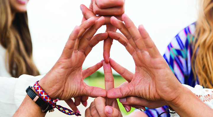 People Make a Peace Sign with Hands