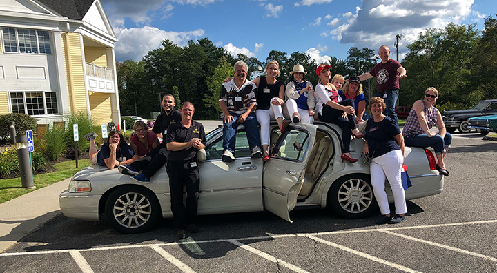 Brandywine Living at Litchfield Team Members Pose with Car