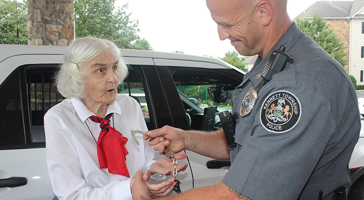 Female Senior Being Handcuffed by Police