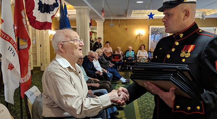 Veteran Shakes Hands with Corporal