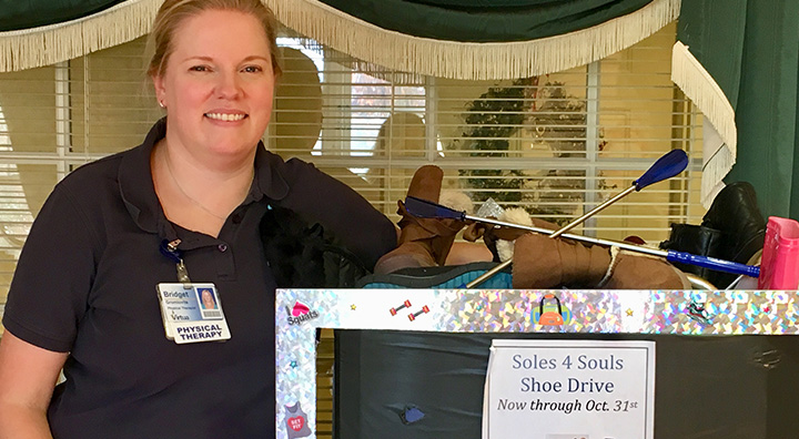 Bridget Gromlovitz Poses with Shoe Drive Box