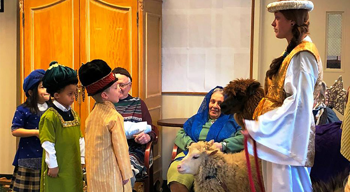 Three Children in Live Nativity with Sheep and Llama