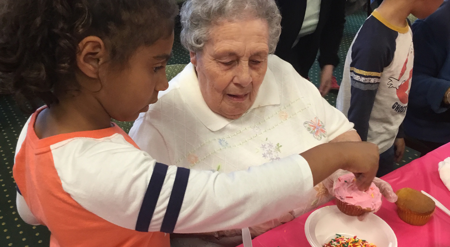 Female Senior and Child Decorate Cupcakes for Easter
